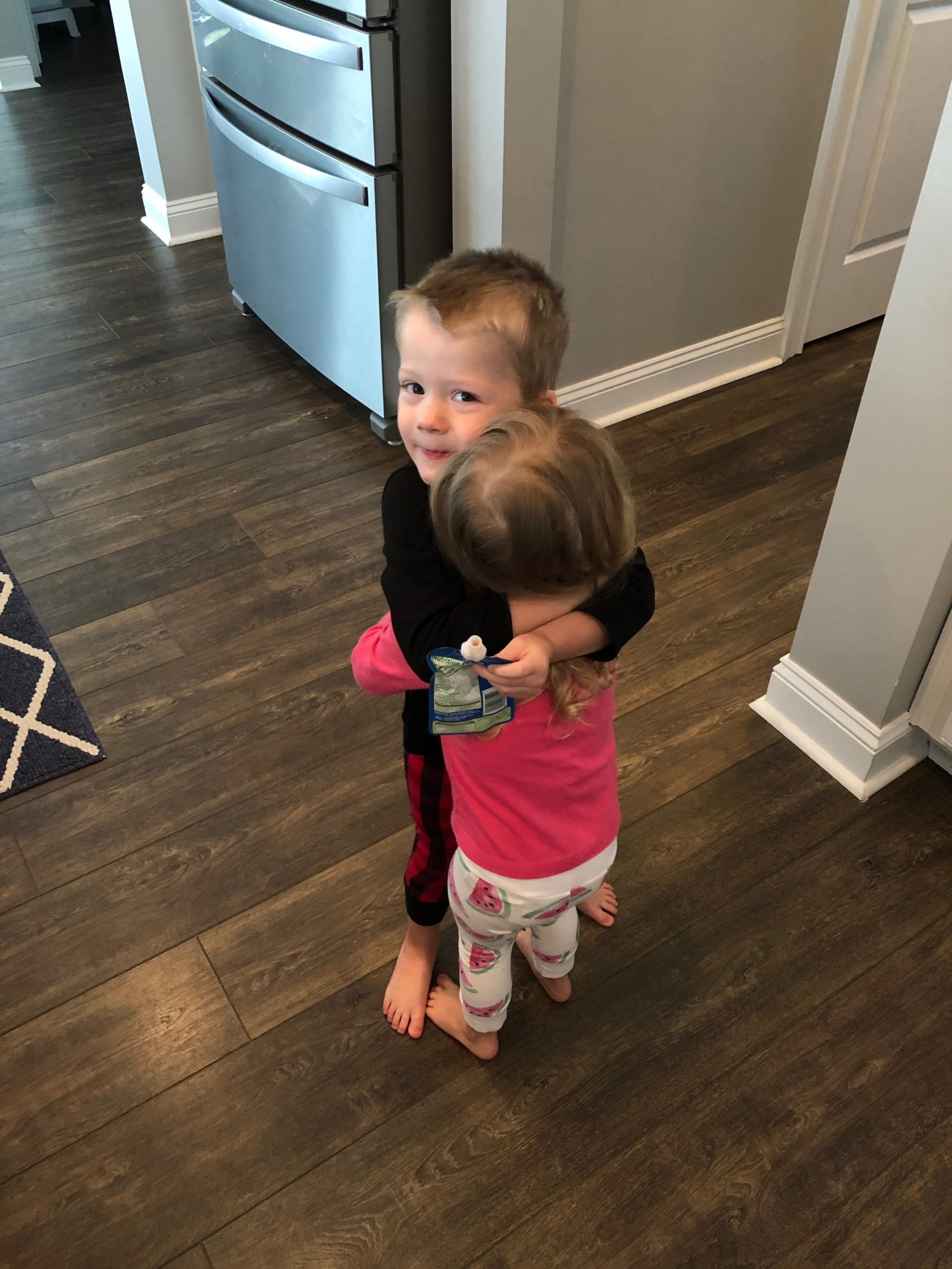 Boy and girl hugging.