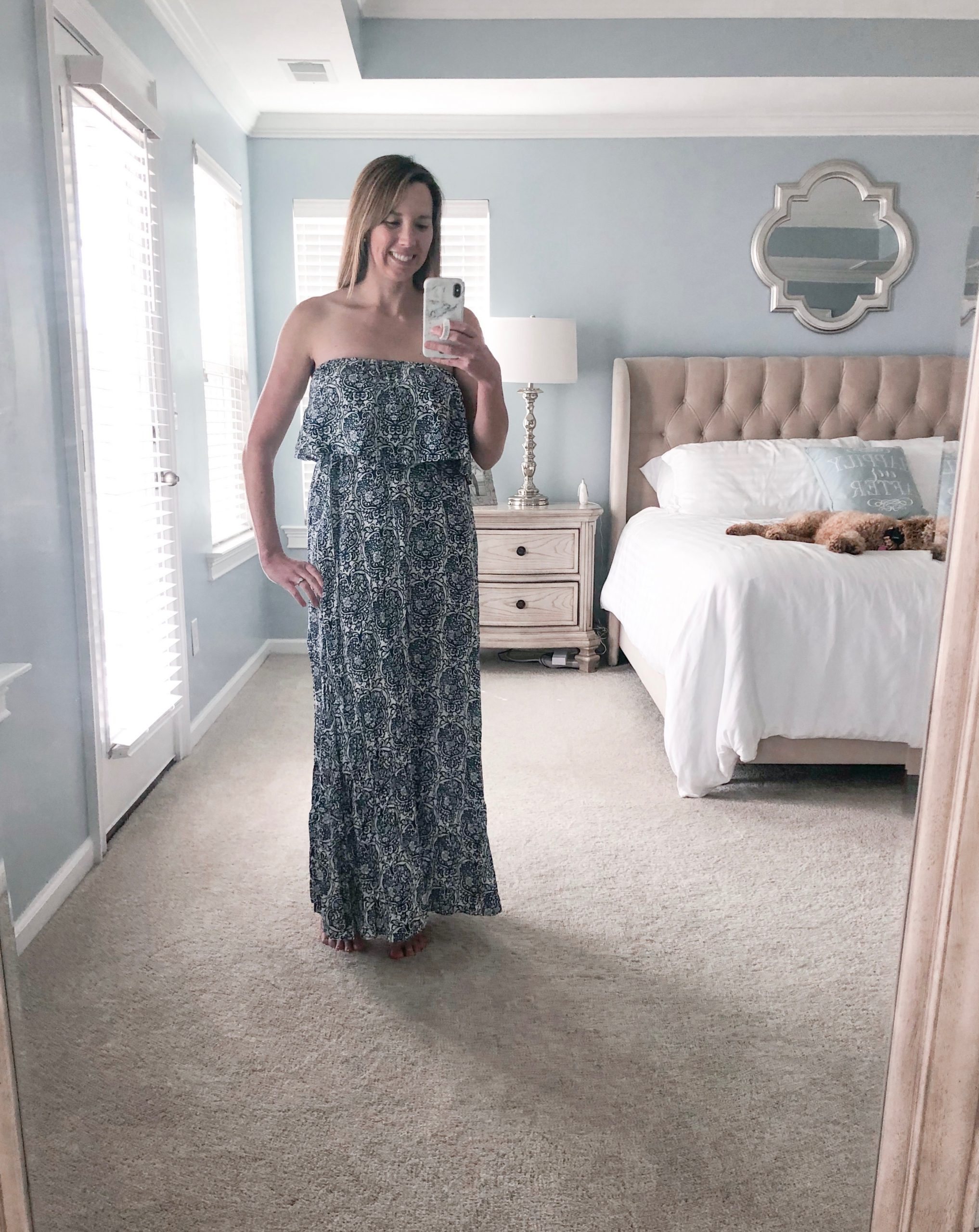 Woman wearing blue and white porcelain strapless boho maxi.