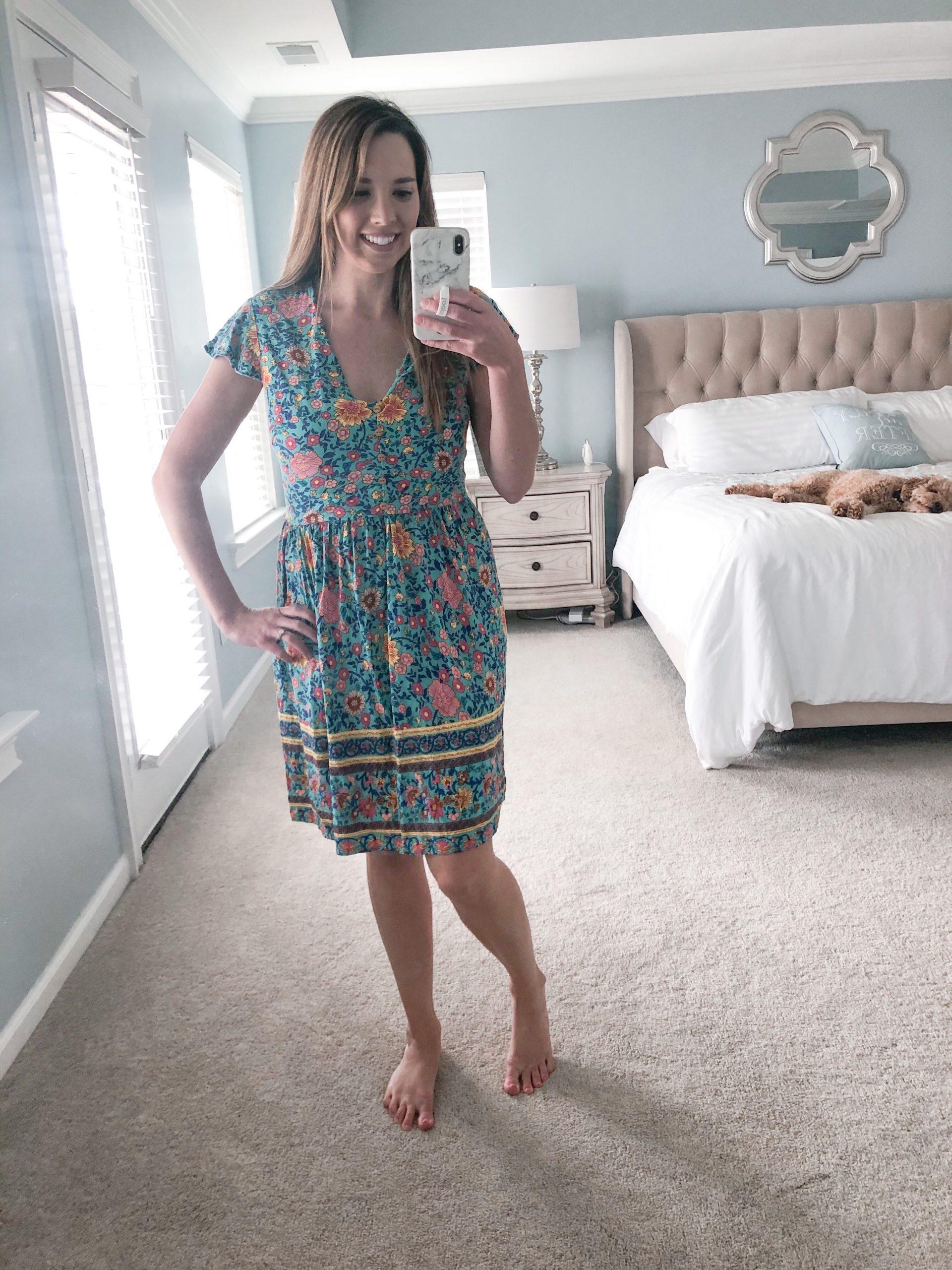 Woman wearing floral boho swing dress.
